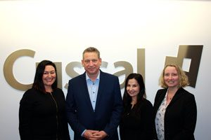 Cusal MD Craig Kennedy with female members of his leadership team